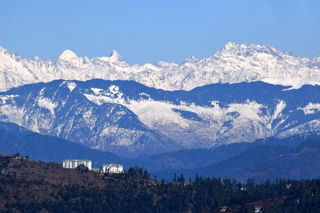 A view of the snow-capped mountain ranges seen from the state capital Shimla on Friday.(Deepak Sansta / HT)