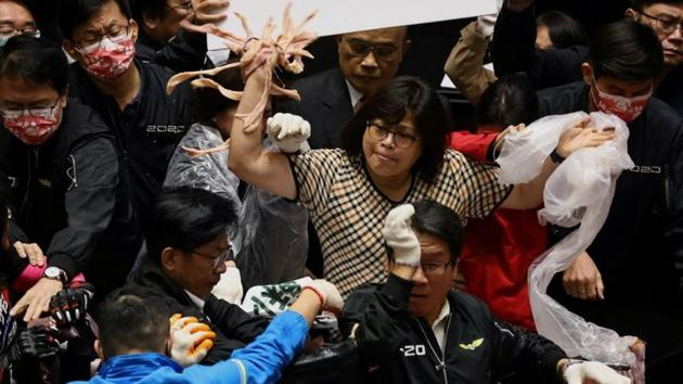 Taiwan lawmakers throw pork intestines at each other during a scuffle in the parliament in Taipei, Taiwan on November 27. (Ann Wang / REUTERS)