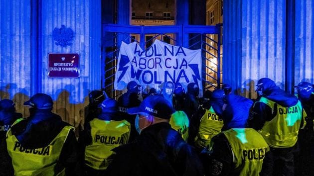 Police try to remove demonstrators taking part in a pro-choice protest outside Polish Ministry of Education in Warsaw, Poland on November 23. A wave of protesters are demonstrating across Poland since October 22 against the country's near-total ban on abortion. (Wojtek Radwanski / AFP)