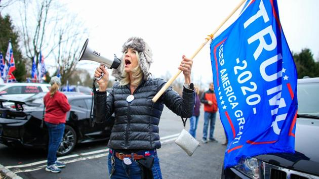 "A woman shouts slogans as US President Donald Trump's supporters gather during a car rally ""Stop the Steal"" in Long Valley, New Jersey, US on November 22. (Kena Betancur / AFP)"