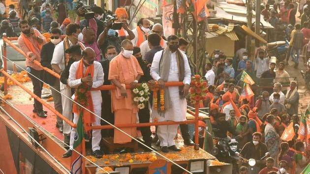 Uttar Pradesh chief minister Yogi Adityanath with other BJP leaders during a roadshow ahead of the GHMC elections in Hyderabad on Nov 28, 2020.(PTI)