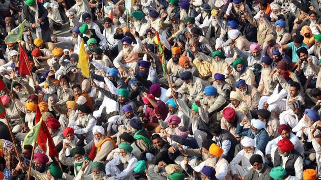 A large number of farmers gather during their protest against the farm laws at Singhu border in New Delhi on Sunday.(ANI)