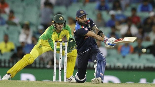 India's Virat Kohli plays a pull shot during the one day international cricket match between India and Australia at the Sydney Cricket Ground in Sydney, Australia.(AP)