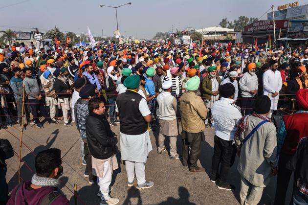 Farmers at Singhu border during their ongoing protest march 'Delhi Chalo' against Centre's new farm laws, in New Delhi, Sunday.(PTI Photo)