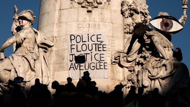 "Demonstrators gathered at the Place de la Republique in Paris on November 28. ""Police everywhere, justice nowhere"" and ""police state"" and ""smile while you are beaten"" were among the slogans brandished as protesters marched from Place de la Republique to the nearby Place de la Bastille, AFP reported. (Joel Saget / AFP)"