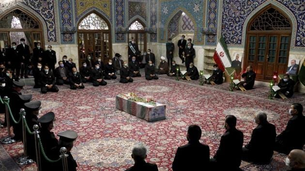 In this picture released by the Iranian Defense Ministry and taken on Saturday, Nov. 28, 2020, people pray over the flag draped coffin of Mohsen Fakhrizadeh, an Iranian scientist linked to the country's disbanded military nuclear program, who was killed on Friday.(AP)