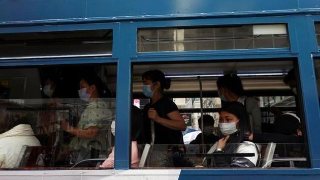 Passengers wearing face masks following the coronavirus disease (Covid-19) outbreak ride on a tram in Hong Kong, China.(Reuters)