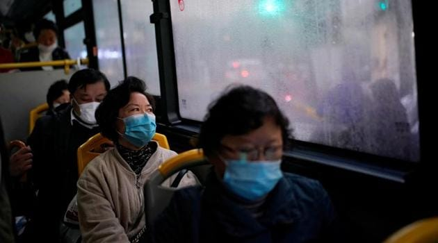 People wearing face masks are seen on a bus amid the global outbreak of the coronavirus disease (Covid-19) in Shanghai, China.(REUTERS)