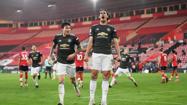 Manchester United's Edinson Cavani celebrates scoring their second goal.(Pool via REUTERS)