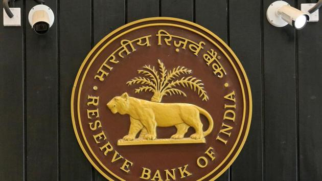 CCTV cameras are seen installed above the logo of Reserve Bank of India (RBI) inside its headquarters in Mumbai, India.(Reuters)
