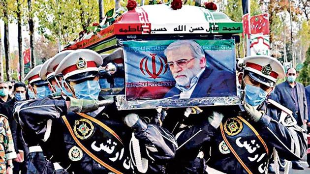 Members of Iranian forces carry the coffin of slain scientist Mohsen Fakhrizadeh during his funeral ceremony in Tehran.