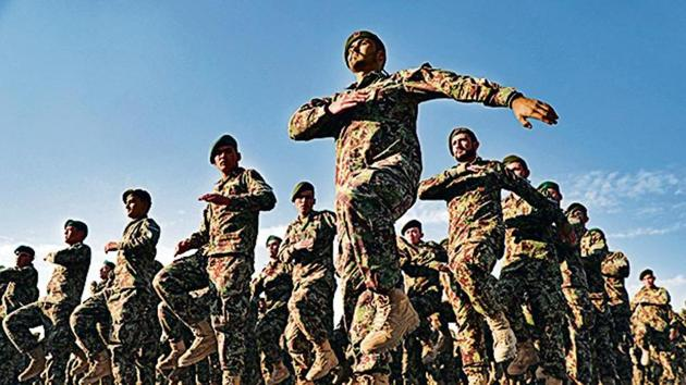 Afghan Army recruits march at a graduation ceremony.