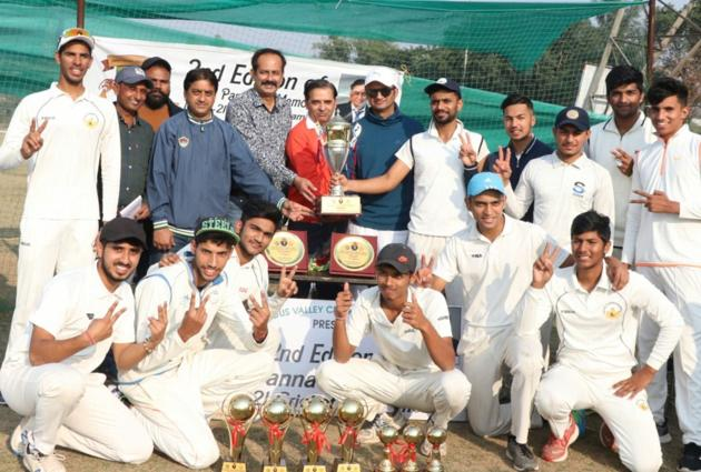 The Chandigarh Cricket Academy winning team with the trophy.(HT Photo)