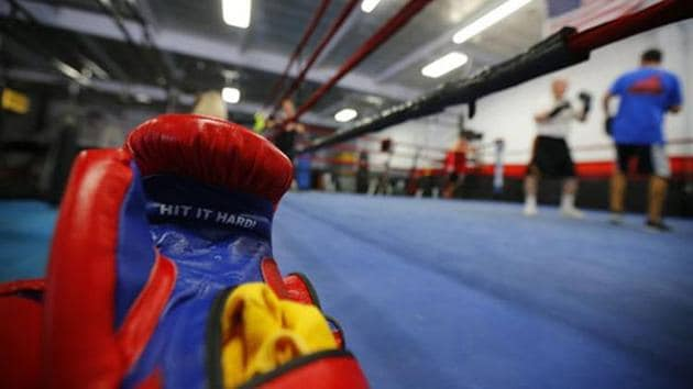 "The words ""Hit Hard"" are written on boxing gloves as parkinson's patients takes part in their twice -weekly rock steady boxing class in Costa Mesa, California.(REUTERS)"