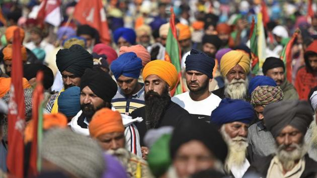 """Farmers offer prayers on the occasion of Guru Nanak Dev Jayanti at Singhu border in New Delhi on November 30. """"We have definitely come here from Punjab but we will celebrate Guruparva the same way we do every year. In Ardas, we pray that our Guru Nanak ji gives good sense to the government so that the """"black laws"""" being imposed on us are scrapped,"""" Bharatiya Kisan Union (Doaba) president Manjeet Singh told ANI. (Biplov Bhuyan / HT Photo)"""