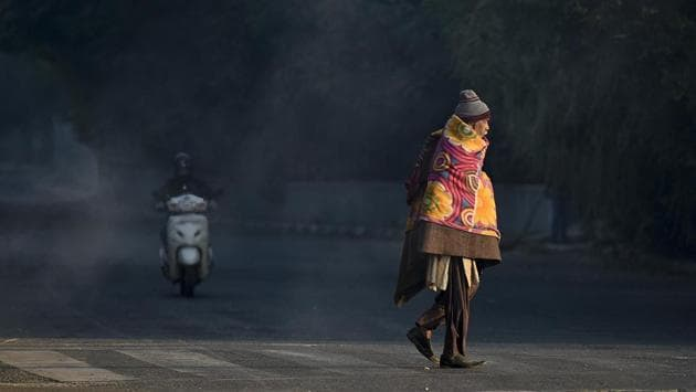 A man wrapped in a blanket crosses a road in Nizamuddin in New Delhi on November 27. Delhi recorded a minimum of 7 degrees Celsius on November 29. This is the seventh day this month that the minimum temperature remained below 10 degrees Celsius. (Biplov Bhuyan / HT Photo)