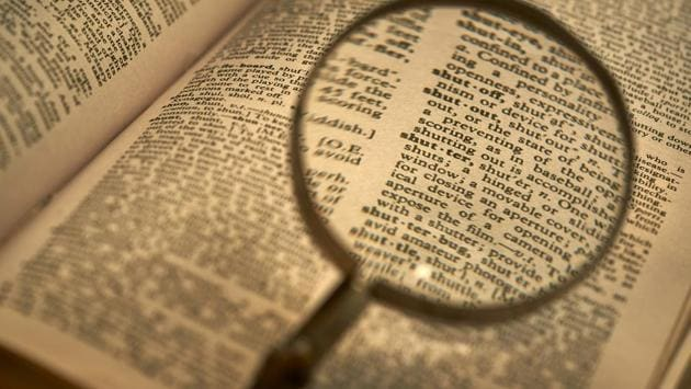 old dictionary with a magnifying glass(Getty Images/iStockphoto)