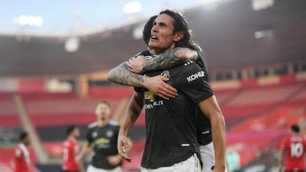 Manchester United's Edinson Cavani celebrates scoring their second goal with Victor Lindelof.(Pool via REUTERS)