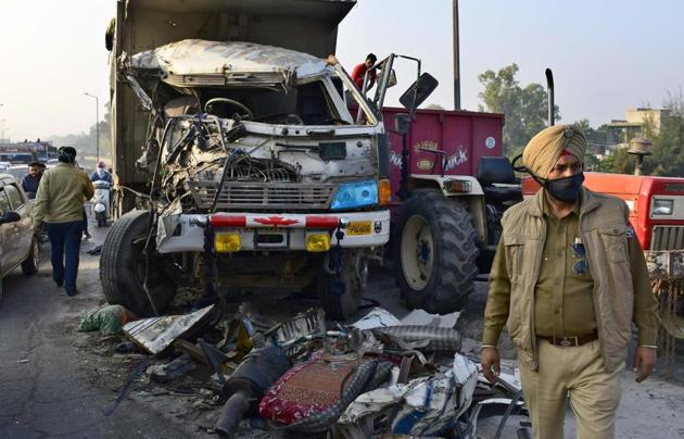 Police getting the mangled remains of one of the trucks removed following the accident at Southern Bypass in Ludhiana on Monday.(Harsimar Pal Singh/HT)