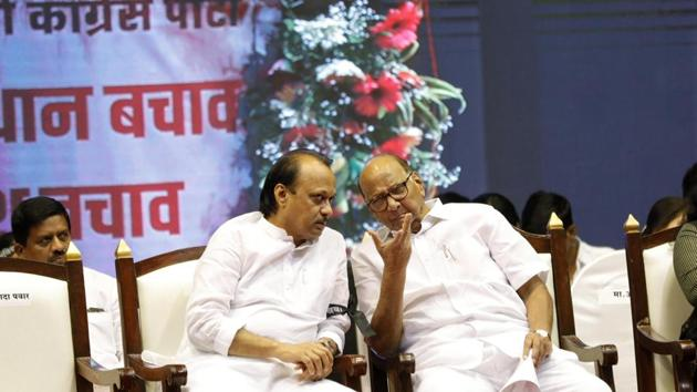 Ajit Pawar with uncle and Nationalist Congress Party chief Sharad Pawar at a rally at Pune on October 29, 2018.(HT FILE PHOTO)