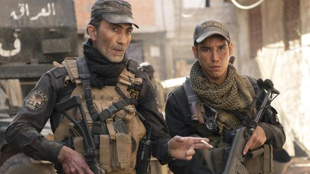 Mosul movie review: Suhail Dabbach as Major Jasem and Adam Bessa as Kawa, in a still from the new Netflix film.(JOSE HARO/NETFLIX)