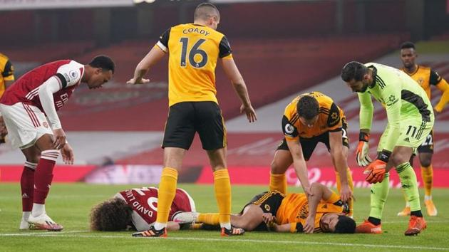 Arsenal's David Luiz and Wolverhampton Wanderers' Raul Jimenez after a head-on collision.(Pool via REUTERS)