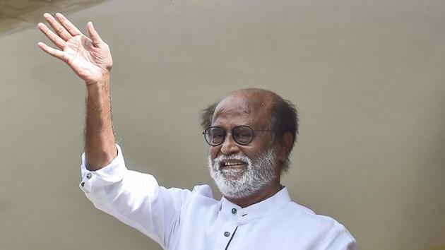 File photo: Actor-turned-politician Rajinikanth waves at his fans.(PTI)