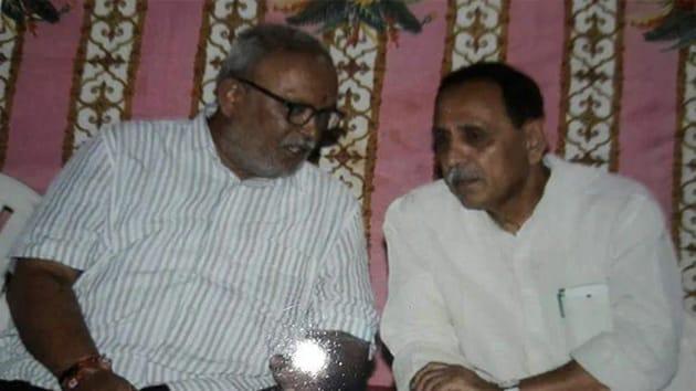 Abhay Bharadwaj with Gujarat chief minister Vijay Rupani(Image via Twitter)