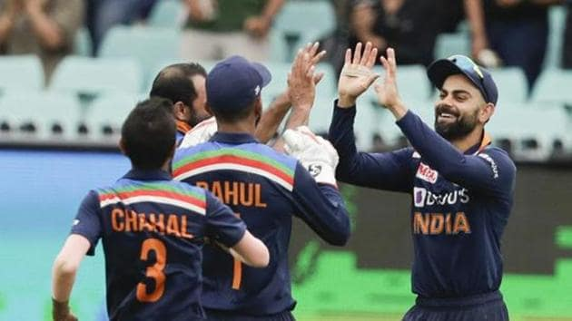 India's Virat Kohli, right, is congratulated by teammates after taking a catch to dismiss Australia's Aaron Finch during the one day international cricket match between India and Australia at the Sydney Cricket Ground in Sydney, Australia, Sunday, Nov. 29, 2020.(AP)