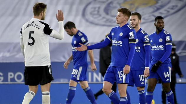 Leicester's Harvey Barnes, front right, shakes hands with Fulham's Joachim Andersen, left, as he leaves the pitch after the English Premier League soccer match between Leicester City and Fulham at the King Power Stadium in Leicester, England, Monday, Nov. 30, 2020. Fulham defeated Leicester by- 2-1.(AP Photo/Rui Vieira, Pool)(AP)