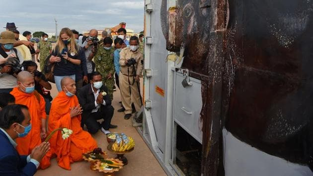 Buddhist monks perform a ceremony to bless the crate containing Kaavan the Asian elephant upon his arrival in Cambodia from Pakistan at Siem Reap International Airport on November 30. The 4,080 kilogram elephant received a warm welcome on arrival from officials, conservationists and the Buddhist monks, who chanted prayers for his harmony and prosperity. (Tang Chhin Sothy / AFP)
