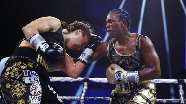 Claressa Shields, right, punches Ivana Habazin during the seventh round of a women's 154-pound title boxing bout in Atlantic City, N.J. Shields is already dominating the boxing world with two Olympic gold medals and professional title belts in three weight classes. Her next world to conquer is mixed martial arts.(AP)