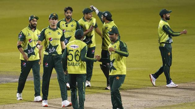 Pakistan players celebrate their win in the third Twenty20 cricket match against England at Old Trafford in Manchester, England.(AP)