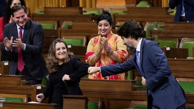 Canada's finance minister Chrystia Freeland receives a fist bump from Prime Minister Justin Trudeau in the House of Commons, in Ottawa, Ontario, Canada on November 30, 2020.(REUTERS)