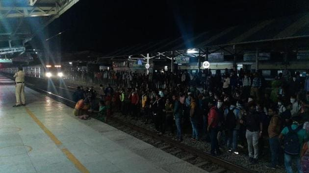 Commuters, mostly eseential services employees blocked rail tracks to protest the proposed change of timings saying they would reach their workplaces late.(HT PHOTO)