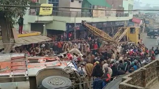Eight people were killed after a truck overloaded with sand toppled over and fell on a car on Tuesday night in Uttar Pradesh's Kaushambi on Wednesday.(HT photo)