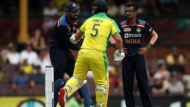 KL Rahul of India and Aaron Finch of Australia joke about after Finch was hit by a full toss.(Getty Images)