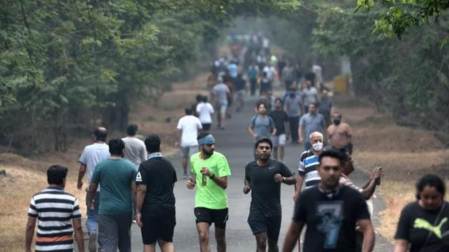 """Morning walkers and joggers out at Sanjay Gandhi National Park in Mumbai on November 28. """"In the past 15 days, the testing has gone up, and we have also witnessed a little surge in the daily cases being reported. With the increase in testing, we will have to wait and watch at least till December 15 to understand better the post-Diwali surge,"""" a BMC official told HT. (Satish Bate / HT Photo)"""