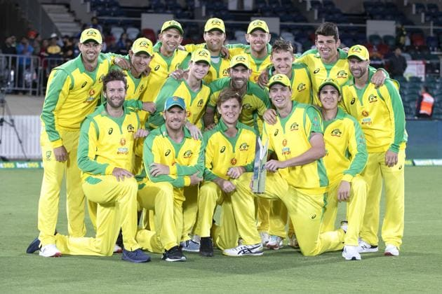 The Australian team pose for a photo with their trophy after winning the one day series against India 2-1 following the final match at Manuka Oval, Canberra, Australia, Tuesday, Dec 2, 2020. (AP Photo/Mark Baker) (AP)