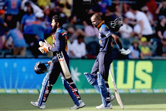 India's batsmen Hardik Pandya (R) and Ravindra Jadeja walk back to the pavilion at the end of 50 overs during the third one-day international cricket match between Australia and India at Manuka Oval in Canberra on December 2, 2020. (Photo by DAVID GRAY / AFP) / / IMAGE RESTRICTED TO EDITORIAL USE - STRICTLY NO COMMERCIAL USE (AFP)