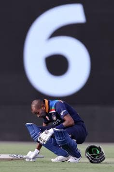 India's batsman Hardik Pandya sits on the ground to restore his energy during the third one-day international cricket match between Australia and India at Manuka Oval in Canberra on December 2, 2020. (Photo by DAVID GRAY / AFP) / / IMAGE RESTRICTED TO EDITORIAL USE - STRICTLY NO COMMERCIAL USE (AFP)