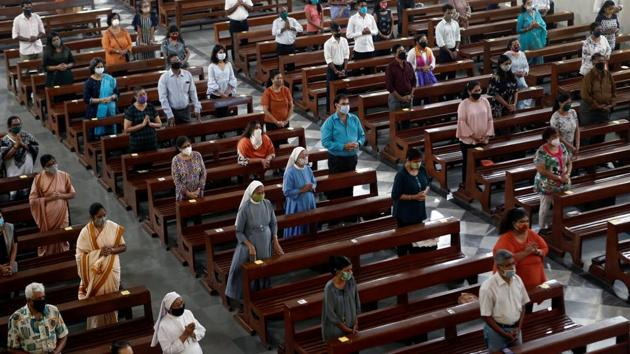 """Devotees wearing masks and keeping physical distance, attend Sunday mass at a church in Mumbai on November 29. Despite official claims and the relaxations, there remains a need for caution. Dr Siddarth Paliwal, a city-based doctor, told HT, """"Cases might have gone down because testing has also gone down. The positivity rate may have gone down due to increased use of rapid antigen kits, which have lower positivity rate in comparison to RT-PCR kits."""" (Francis Mascarenhas / REUTERS)"""