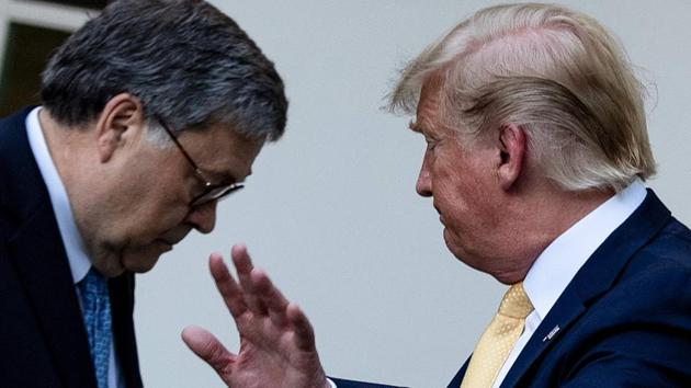 US Attorney General William Barr (left) and US President Donald Trump at the White House in Washington, DC last year.(AFP/ file)
