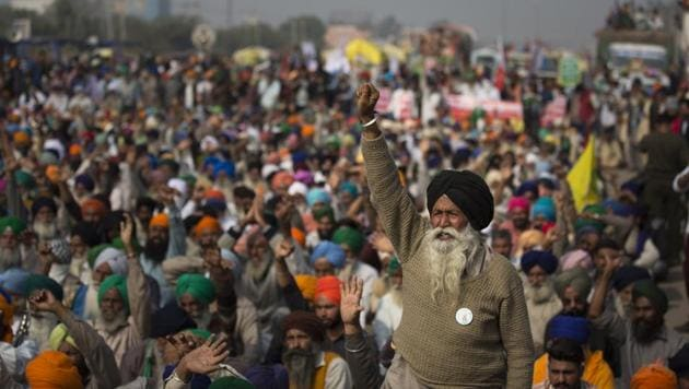 An elderly farmers shouts slogans as others listen to a speaker as they block a major highway during a protest at the Delhi-Haryana state border, India, Tuesday, Dec. 1, 2020.(AP)