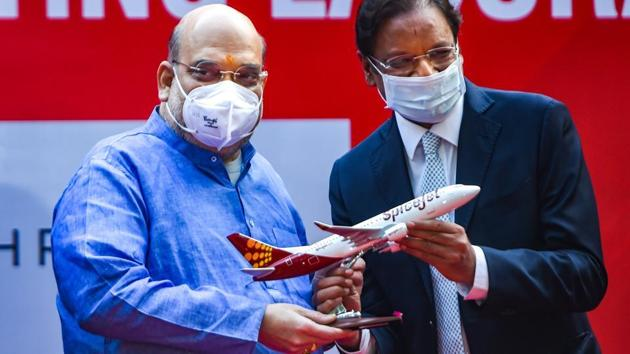 Union Home Minister Amit Shah and Spicejet CMD Ajay Singh launch a mobile RT-PCR lab at ICMR headquarters.(PTI)