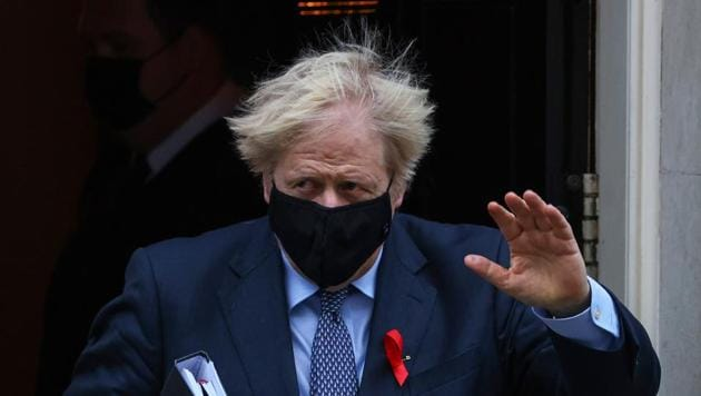 Boris Johnson, U.K. prime minister, waves as he departs from number 10 Downing Street on his way to Parliament in London.(Bloomberg)