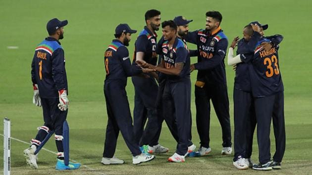 The Indian cricket team celebrates its 13-run win against Australia.(Getty Images)