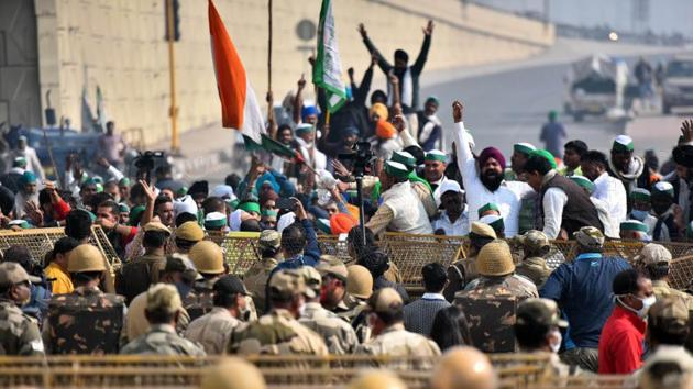Farmers protest across police barricades at the Delhi-Ghazipur Border, in New Delhi on December 1. While the farmers want the three farm laws approved by Parliament in September to be revoked, the government has leaned on its new reform agenda for better crop prices and higher investments in the farm sector. (Raj K Raj / HT Photo)