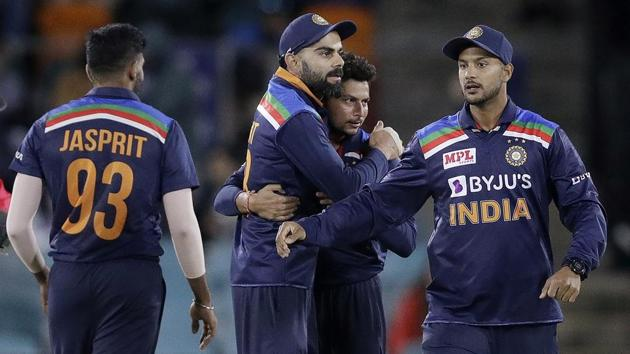 India's Virat Kohli, second left, celebrates with teammates.(AP)