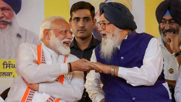 File Photo: Prime Minister Narendra Modi with Shiromani Akali Dal leader Parkash Singh Badal in Bathinda (PTI Photo) (PTI27-09-2020_000052A)